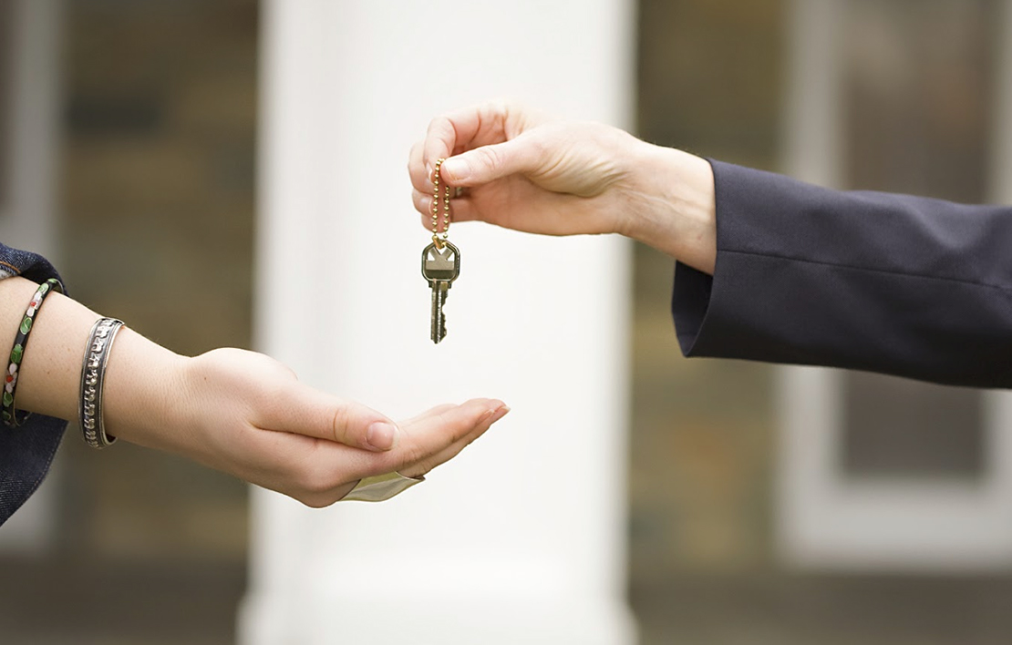 Picture of a woman handing a key to another woman