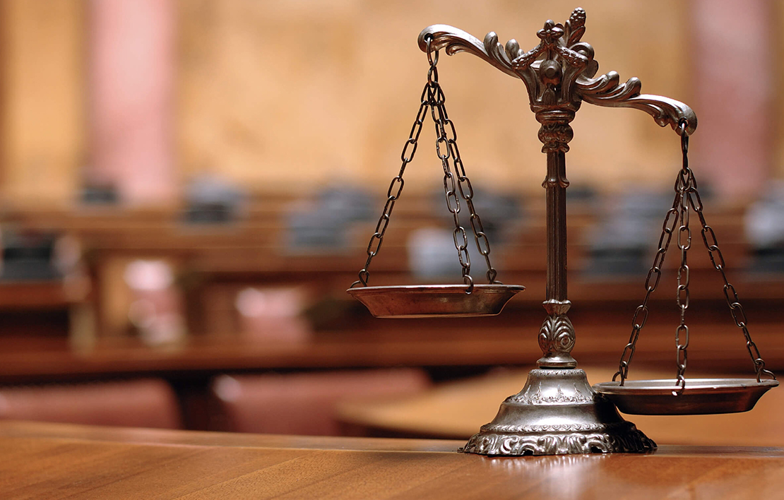 Scales of justice in a courtroom